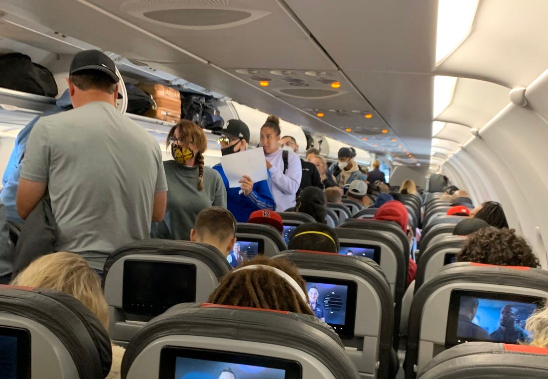 Crowded Aircraft Aisle during Boarding